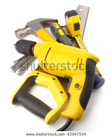 Heap of a few carpenter instruments, isolated over white - stock photo