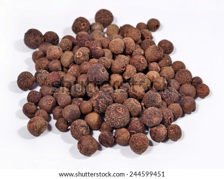 Heap of allspice on a white background - stock photo