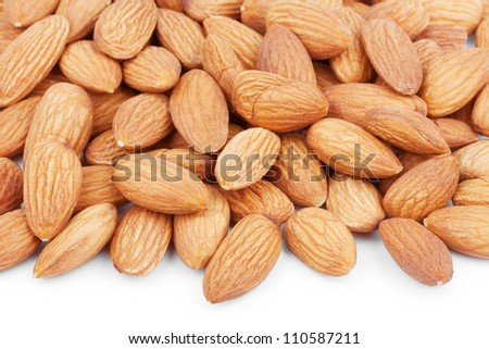 Heap of almond nuts on white background - stock photo