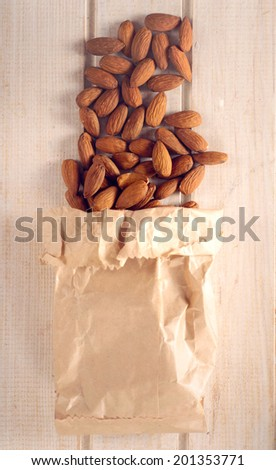 Heap of almonds in the bag from above.Selective focus on the almonds - stock photo