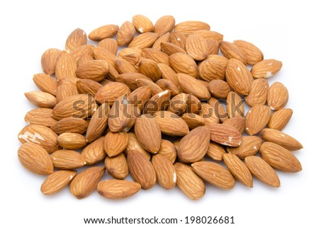 Heap of almonds, isolated on white