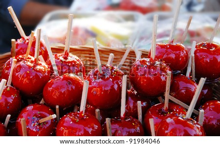 heap of appetizing red taffy apples outdoors
