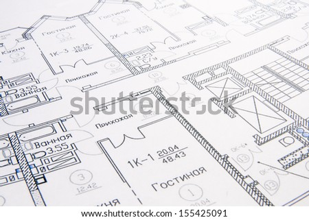 heap of architect design and project drawings on table background