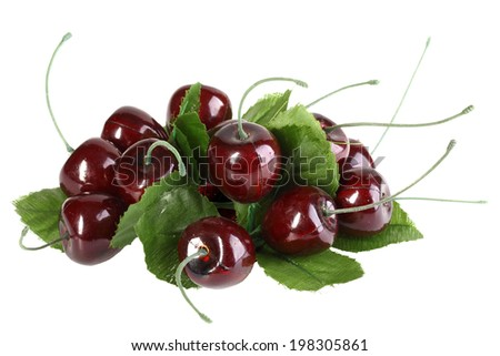 Heap of artificial several cherries with leafs. Isolated on white background. Close-up. Studio photography. - stock photo