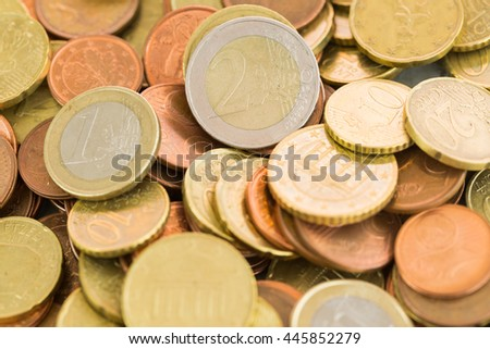 Heap of assorted Euro coins in different denominations in a vertical shallow dof view in a full frame financial background - stock photo