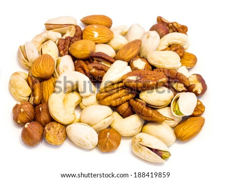 Heap of assorted nuts  isolated on white background , macro image . - stock photo
