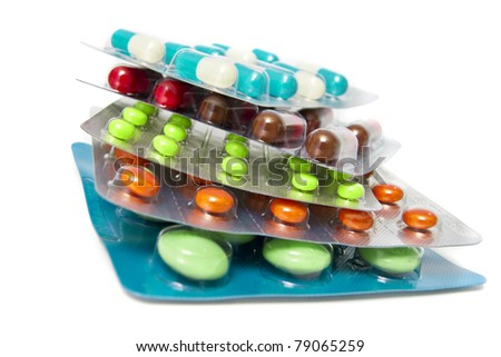 Heap of assorted pill packages - stock photo