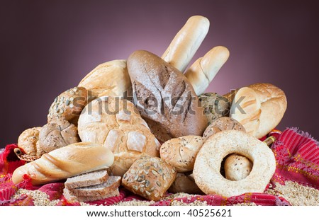 Heap of assortment of bread on nice background - stock photo
