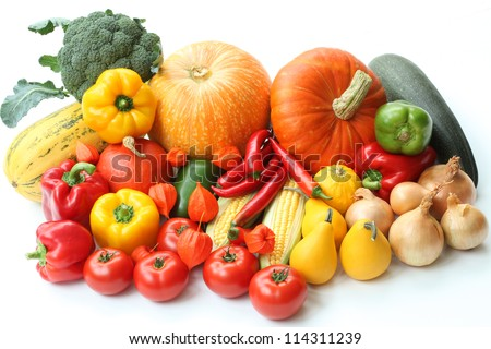 Heap of autumn vegetables on isolated white background