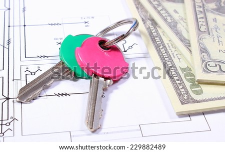 Heap of banknotes and home keys lying on electrical construction drawing of house, concept of building house - stock photo