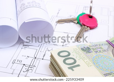 Heap of banknotes, home keys and rolls of electrical diagrams lying on construction drawing of house, concept of building house, drawings for the projects engineer jobs - stock photo