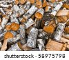 heap of birch firewoods - stock photo