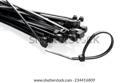 heap of black cable ties on white background