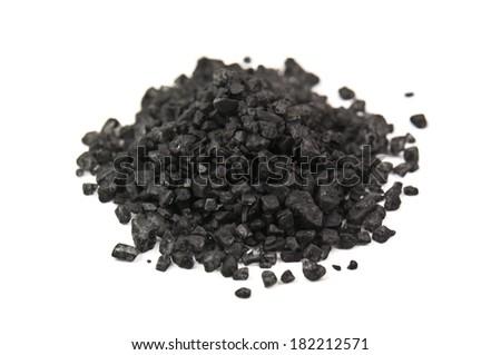 heap of black Hawaiian lava salt on white - stock photo