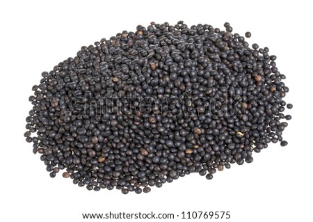 Heap of black lentil isolated on white