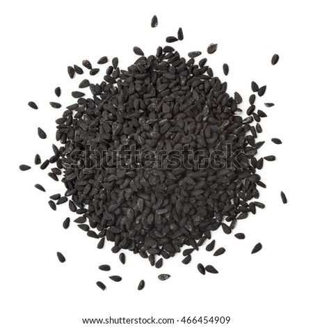 Heap of black nigella seeds on white background
