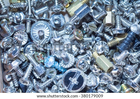 heap of bolts and screws. Macro shot. - stock photo