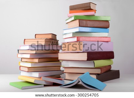 Heap of books on grey background - stock photo