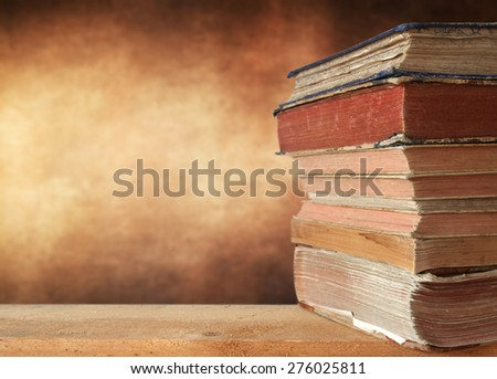 Heap of books with brown background - stock photo