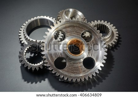 heap of brilliant gears on a black background - stock photo