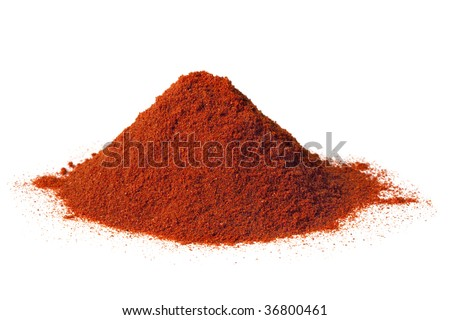 Heap of brilliant red sweet paprika, isolated on white.