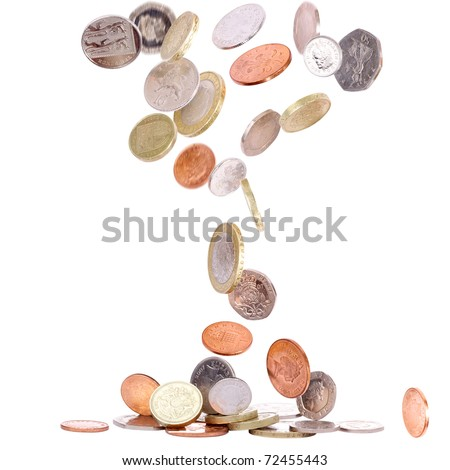 Heap of british coins falling to the ground - stock photo
