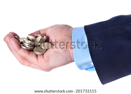 Heap of British pound sterling coins in the hand of a businessman on white background - stock photo