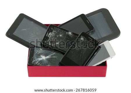 Heap of broken  personal no name mass production electronic gadgets in red paper box.
