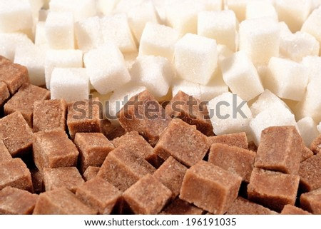 Heap of brown and white refined sugar as background  - stock photo