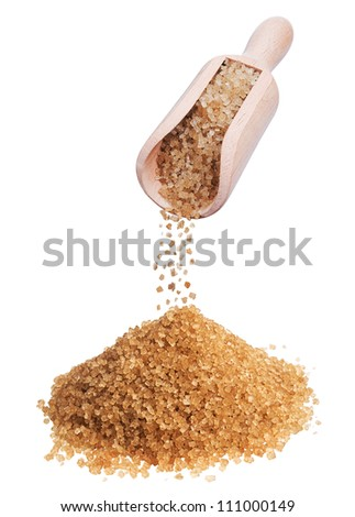heap of brown sugar and wooden scoop on white background - stock photo