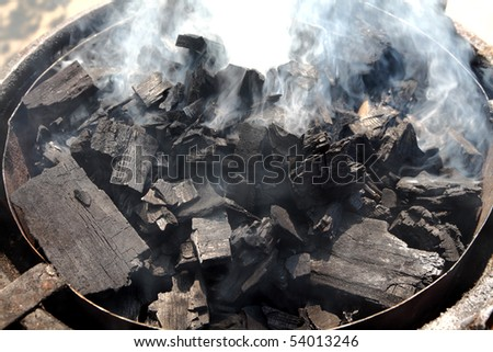 Heap of burning charcoal coal for barbecue in close up - stock photo