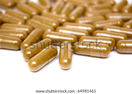 heap of capsules isolated on white - stock photo