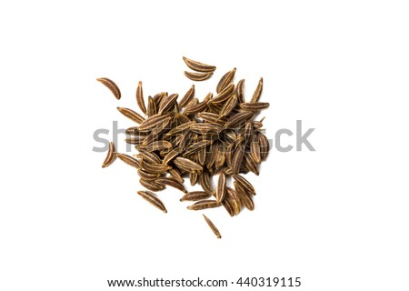 Heap of caraway seed isolated on white background, view from above, closeup. - stock photo