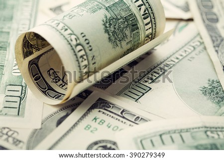 Heap of cash US dollar bills background, closeup
