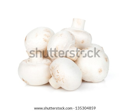 Heap of champignon mushrooms. Isolated on white background - stock photo
