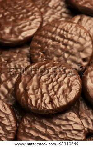 Heap of chocolate cookies as background. - stock photo