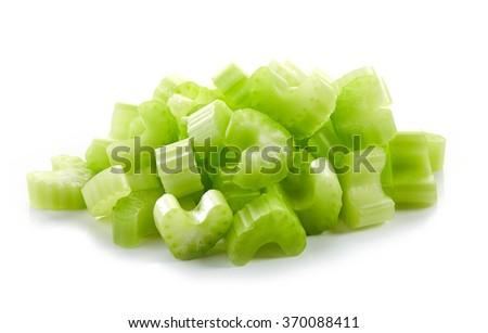 Heap of chopped celery sticks isolated on white background - stock photo