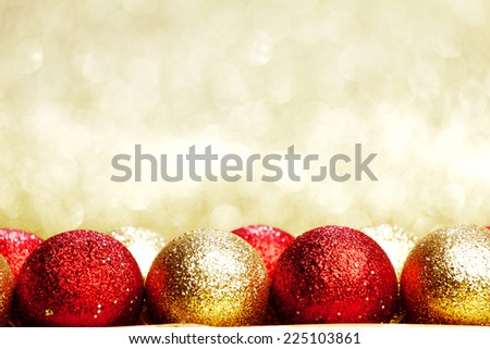 Heap of Christmas balls on golden background - stock photo
