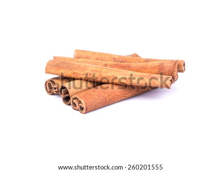 Heap of cinnamon sticks on a white background - stock photo