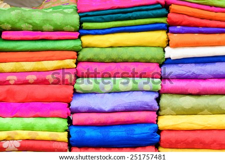 Heap of cloth fabric at local market in India