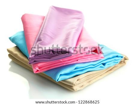 heap of cloth fabrics isolated on white - stock photo