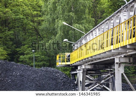 Heap of Coal and Mining Infrastructure - stock photo