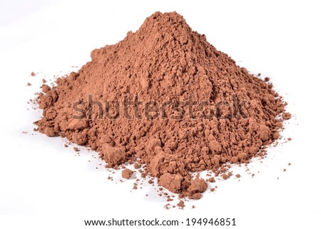 Heap of cocoa powder on a white background - stock photo