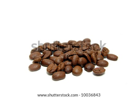 Heap of coffee beans isolated on white