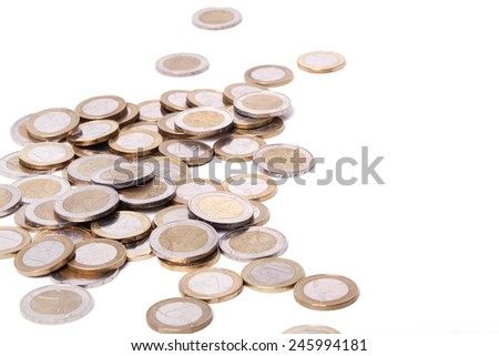 Heap of coins on a white background - stock photo