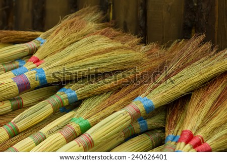 heap of colored  unusual brooms