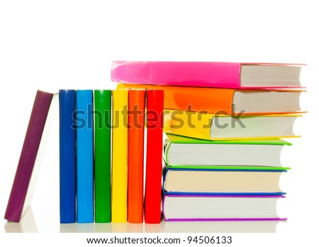 Heap of colorful books over white background