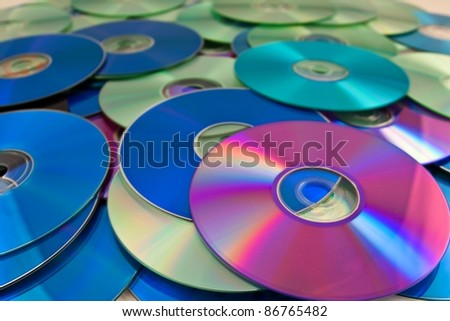 heap of compact disk as a background - stock photo