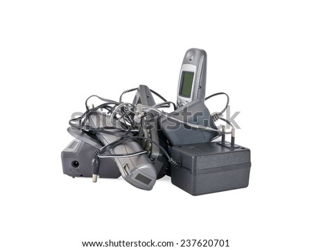 Heap of cordless telephones and cables isolated on white background - stock photo