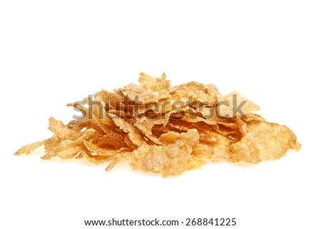 Heap of cornflakes isolated on white background - stock photo